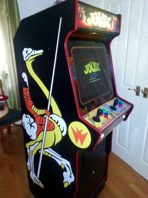 Photo of the finished arcade machine, with Joust artwork on the side, playing Joust